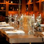 Copperleaf Bar's Tuscan table functions either as a communal table or a reserved party of 10.