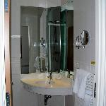 Part of the modern ensuite bathroom (sink/mirror)
