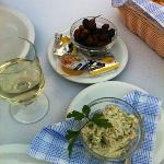 Tasty authentic starter of fresh olives and paste with house white wine
