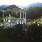 A gazebo by the lake in the morning.