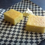 Warm sweet cornbread with honey butter served when you are seated.