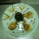 Seppioline al forno con timballo di spinaci