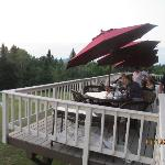 Outdoor dining porch on back of lodge with views of lake.