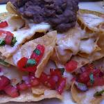 Nachos with black beans paste