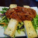 Tofu and Kim-Chi, sauteed kim-chi on top of the pan grilled tofu with organic romain heart salad