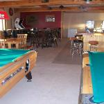 Pool table, Golden Tee Golf, Poker machines, touch screen games, and music available here