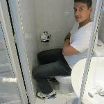 Paul in the bathroom demonstrating how small it is!