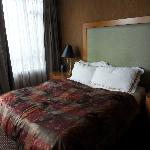 Deluxe room queen bed.