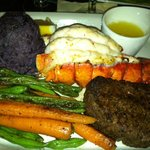 Surf and Turf, Lobster and Filet with green beans, carrots and purple mashed potatoes.