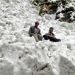 Villagers on top a frozen glacier,near Chitkul