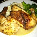Half broiled chicken with broccoli and mashed potatoes.