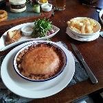 Cheese and Onion pie, delicious burger in background