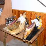 Serrano and Iberic legs of ham, freshly sliced by hand, to order