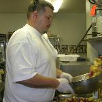 Executive chef Stacy Miller tosses pasta in the kitchen.