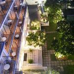View down from 4th floor bar/restaurant to garden where breakfast is taken