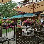 Outdoor summer dining along Gore Creek at Lancelot