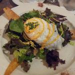 Crab cake on salad with a fried egg and spiced mayo