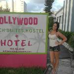 me and our hotel sign