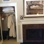 Robes and fireplace in the room