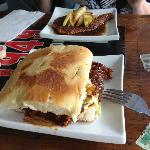 Pulled Pork Sandwich with Salmon Entree in background