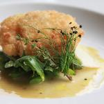 Deep fried poached egg, asparagus in butter sauce