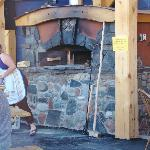 The new brick oven, outside one of the classroom and store building