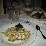 Grouper topped with crab and shrimp and grits