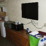 Nice size TV, refrigerator & coffee maker