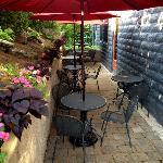 Cute patio with umbrellas, flowers and a peaceful fountain