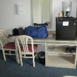 table, chairs and the only storage in the room other than closet