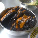 Coal-black chicken wings with housemade sriracha