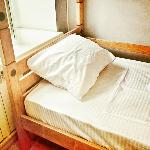 New wooden beds with comfy mattresses and pillows