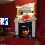 "Guest sitting room with 48"" plasma tv and dvd player"