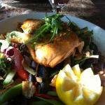 A seafood menu option was this green salad topped with salmon.