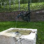 An original fountain in the courtyard.
