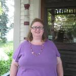 me, on porch, in front of main door entrance