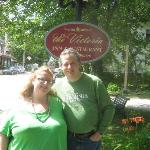 my husband, and I, in front of the Inn, by one of the signs