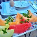 Fresh melons and soft cooked egg in egg cup.