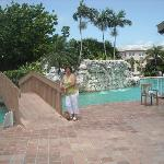 bridge to pool, water cascade at pool. front of pool, kids pool dirty.