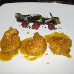 Prawns with crispy fish skin over peeled grapes