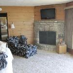 TV, fireplace and seating on one side of cabin.