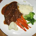 Pot roast with mashed potatoes and steamed vegetables