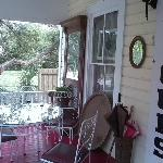 Our favorite spot on the front porch. There is a huge tree across from B&B with Spanish moss..pr