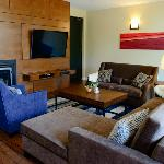 The living room in the Fitch Mountain Suite offers a 55-inch TV and fireplace.