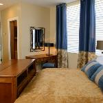 Each bedroom comes with a 42-inch TV in a tasteful cabinet at the end of the bed.