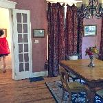 Downstairs Heritage House, daughter reading framed articles