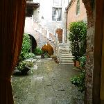 entering through street door into private area and court yard, with staircase to Palazzo Odoni