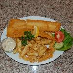 Flaky fish cooked to order in light golden batter