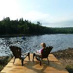 Peaceful reading near the lodge's own lake