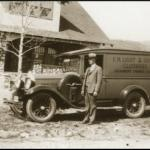 Clarence Light, with the truck that was used to sell clothing to ranches during the Depression
